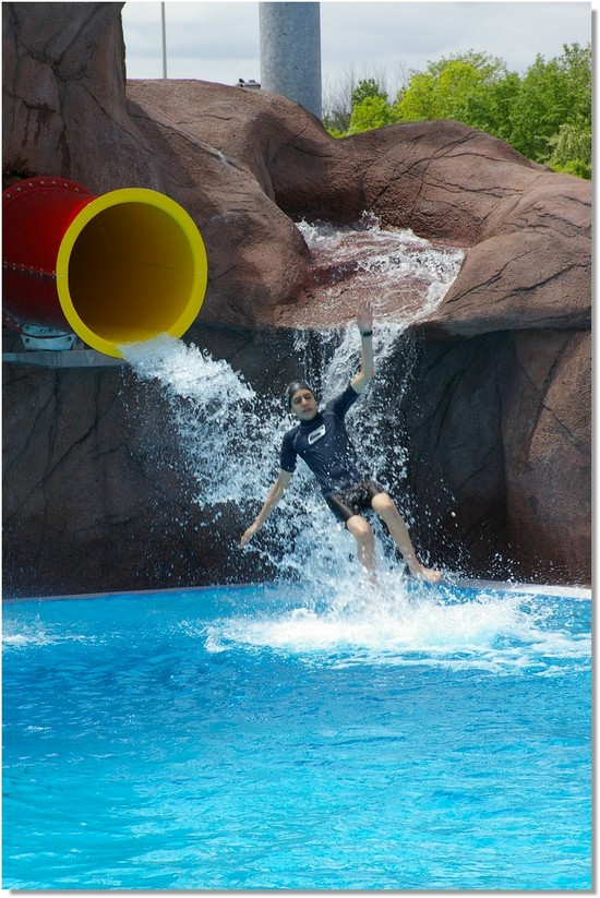 Boy Shooting out of Red Drop Slide